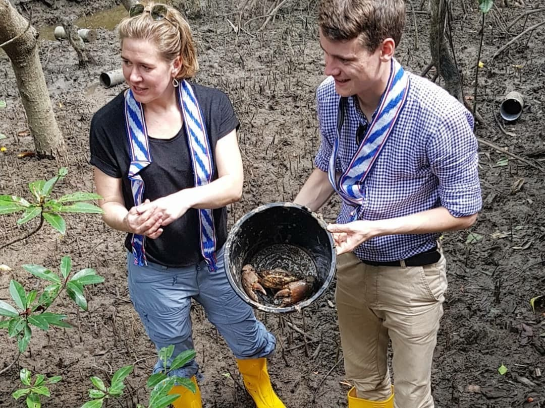Member of Parliament Mr. Tore Storehaug and Ms. Anja Lillehagen from Rainforest Foundation Norway harvesting crabs in Tanjung Harapan.